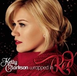 """Ganz in rot: Kelly Clarkson gut verpackt auf dem Cover von """"Wrapped in Red"""""""